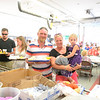 Emil Roland and his wife Meredith and daughter Reese finish making their dinner plates including lobster, corn, and dinner rolls. In line behind them are Dawnielle Conger and Matt Amaral. (Bobowick photo)