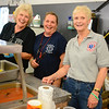 In the serving line are fire company volunteers, from left, Joyce Staudinger, Donna Liska, and Sue Shpunt. (Bobowick photo)