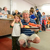 Brian Daly and his son Quentin have a tray loaded with lobster and trimmings Saturday evening. (Bobowick photo)