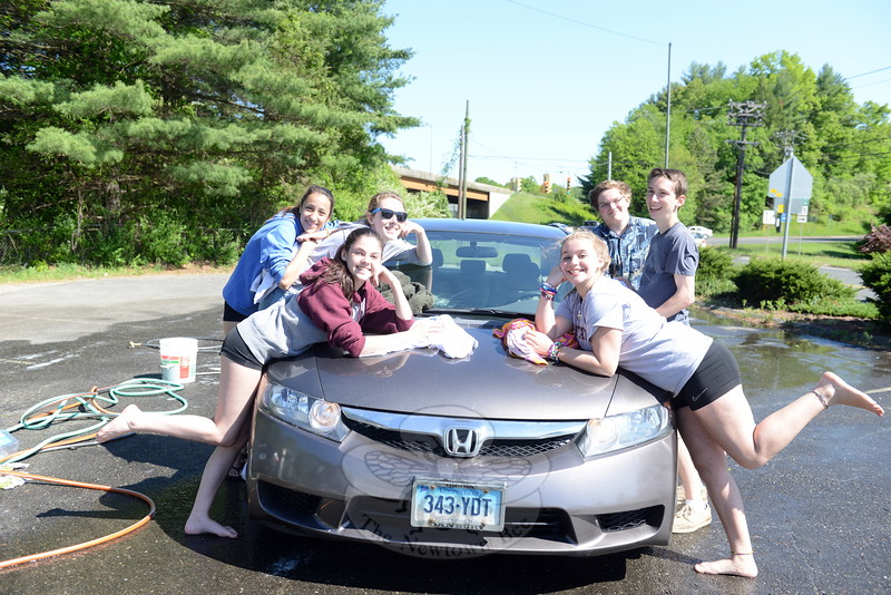 "Students and ""Working Toward a Brighter Future"" team members raised money supporting their Relay For Life participation by holding a car wash Saturday, May 23. From left are Brianna Forlenzo, Sammi Olah, and Maggie Koekkoek. Right are Zoe Lloyd, Max Ames, and Jordan Klein. Organizers and volunteers are in the final stages of preparing for the June 13 event at Blue & Gold Stadium at Newtown High School. (Bobowick photo)"