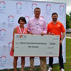 Michael Barrett, vice president of grants for the ASPCA, stands with Jenny and Matt Hubbard and a facsimile of a $50,000 check presented to the CVH Foundation. (Crevier photo)