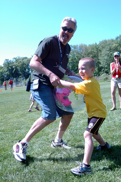 Hawley Elementary School Principal Christopher Moretti jumped in line at the Beach Ball Relay station during his school's Field Day when he noticed one team was a kid short. Mr Moretti and student Jackson Kost, right, raced the course together. (Hallabeck photo)