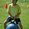 "Head O' Meadow Elementary School's Spirit Day was held on Friday, May 29, with a rainbow of teams taking part in the day's events. After gathering for brief remarks by the ""Spirit of Spirit Day"" (parent volunteer Doug Ballard), Coach Steve Dreger gave the signal and teams spread out to pit their skills against each other in activities from a soccer dribble to a sack race to a water balloon toss and more. (Crevier photo)"