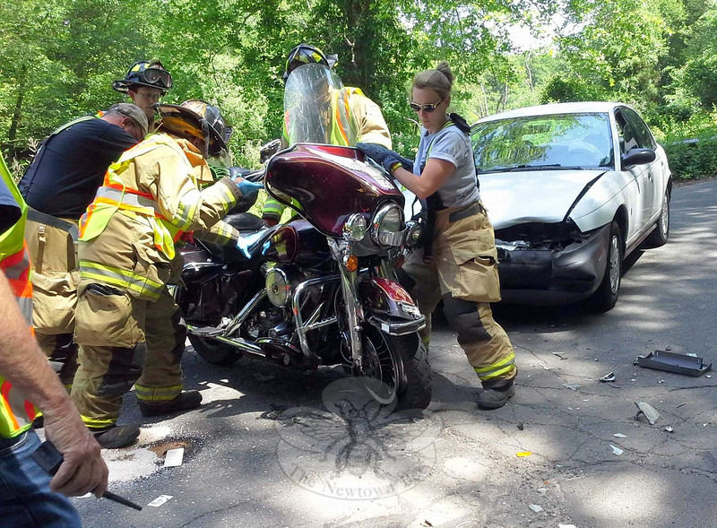Police report an accident involving a motorcycle and a sedan about 1:31 pm on June 7 on Walnut Tree Hill Road, near its intersection with Alberts Hill Road. Police said motorist Theresa Ohradan, 50, of Easton was driving a 1996 Saturn SL-1 sedan northward on Walnut Tree Hill Road, as motorcyclist Salvatore Scianna, Jr, 67, of 172 Walnut Tree Hill Road was riding a 1985 Harley-Davidson FLHT Electra Glide southward on Walnut Tree Hill Road. The Saturn then entered the opposite lane and struck the motorcycle, police said. The Newtown Volunteer Ambulance Corps transported Scianna to Danbury Hospital for treatment of injuries, police said. Sandy Hook volunteer firefighters responded to the accident. Ohradan received a written warning for failure to drive to the right, police said. (Hicks photo)