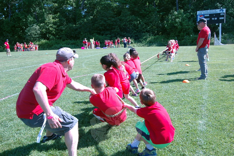 Hawley Elementary School held its Field Day on Friday, May 29. Tug of war was one station during the event, and parent volunteers and teachers occasionally stepped in to help. (Hallabeck photo)