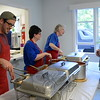 In the serving line guests receive their pasta, sauce and a serving of bread. Among those volunteering as servers on June 6 were, from left, NUMC Youth Leader Brendan Fox, Jan DePalo and Marsha Maurer. (Bobowick photo)
