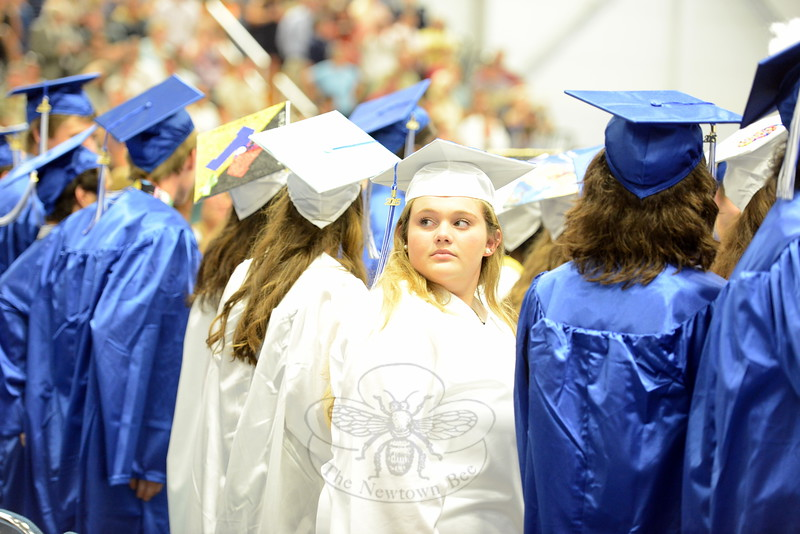 One young woman takes a last glance behind her before the ceremony began Tuesday afternoon, when roughly 450 students graduated from Newtown High School. (Bobowick photo)