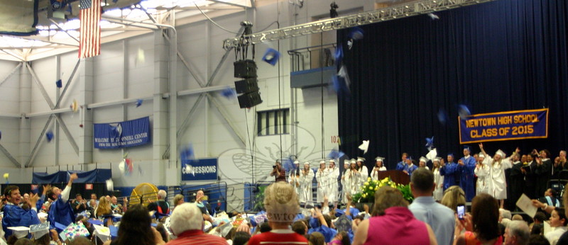 Around 5:30 Tuesday, June 16, mortarboards were in the air and a collective roar of applause grew inside the O'Neil Center at Western Connecticut State University as the Newtown High School's Class of 2015 officially became high school graduates. (Hicks photo)