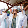 With strands of blue and gold foil star decorating her cap, an excited Eliza Eggleston gets ready to head into the O'Neill Center with friends and fellow classmates for graduation exercises. (Bobowick photo)