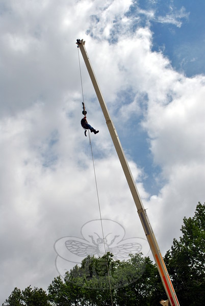 Newtown Arbor Services owner Alan Potter is up, up, and away on a truck crane. (Crevier photo)