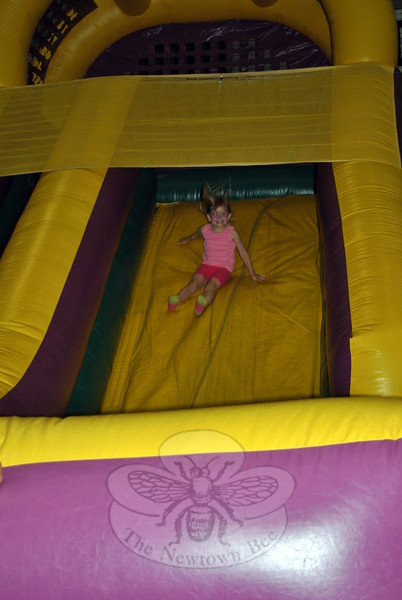 Emma Hettenbach, 4, flies down the bouncy slide during the June 6 Merryhill Child Care celebration at NYA. (Crevier photo)
