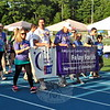 Survivors and caregivers joined together for the first lap at the 2015 Relay For Life event at the Newtown High School Blue & Gold stadium. (Hallabeck photo)