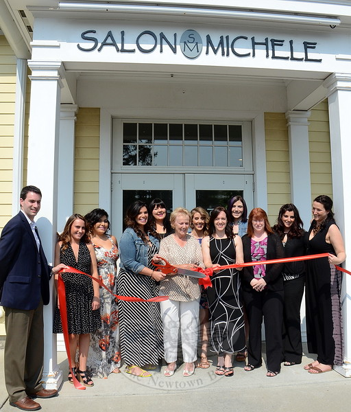 Town officials joined Salon Michelle owners and staff for a ribbon cutting celebrating the business' new location at the corner of Queen Street and Church Hill Road. Among those attending are, from left, Newtown Economic Development Commissioner Matt Mihalcik, Kerry McKenna, Ashley Hernandez, Michelle Schettino-Hawli, Jacquie Davis, First Selectman Pat Llodra, Alison Carrier, Kathy Leaman, Mary Strantini, EDC Chair Jean Leonard, Jackie Stakel, and Cathy Kallay. The salon is planning a public grand opening event on July 25. (Voket photo)