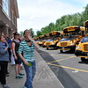 Reed Intermediate School educators waved goodbye next to teachers and staff at his school, while holding smiley faces, as buses left the school for the last time this school year. (Hallabeck photo)
