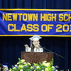 "Salutatorian Hannah Grant gestures during her speech, often waving in recognition of classmates she mentions. She said that 2015 was the ""best class ever,"" as she noted her friends' accomplishments as they would soon begin ""life outside of Newtown."" (Bobowick photo)"