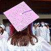 "Mairin Hayes decorated her mortarboard with the ""Shakespeare sparkles in  pink"" Hamlet quote, ""We know what we are, but know not what we may be.""	(Bobowick photo)"
