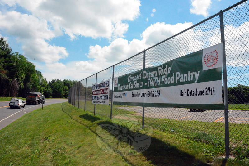 On Wednesday, June 17, these two banners were on display on a chain link fence along the eastbound side of Wasserman Way at Fairfield Hills in the area where Danbury Hall formerly stood. The town recently stopped displaying such banners above Queen Street, near Newtown Middle School, resulting in such signs being posted elsewhere.  (Gorosko photo)