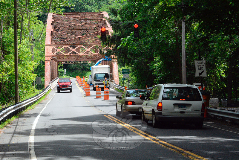 Work crews have set up barriers on the Silver Bridge and installed traffic signals at both ends of the span to create alternating one-way traffic flow there while a major bridge renovation project is under way. The bridge crosses the Lake Zoar section of the Housatonic River, linking Glen Road in Sandy Hook to River Road in Southbury. The $4.47 million state project is expected to be completed in about a year. (Gorosko photo)