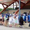 Students, staff, parents, and friends wait outside the O'Neill Center Tuesday evening. Many wore smiles along with their caps and gowns, about two hours away from receiving their high school diplo-mas. (Bobowick photo)