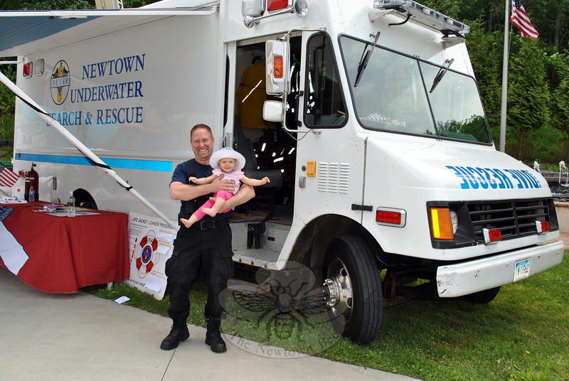 NUSAR Assistant Chief Brain Solt holds his daughter, 11-month-old Gracie, at the Merryhill Touch-A-Truck event, June 6. (Crevier photo)