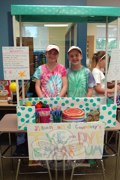 "Reed Intermediate School sixth grade students Jillian Clure, left, and Courtney Henchcliffe stood at their pushcart for Pushcart Day, held on Tuesday, June 9. The girls sold pencils, pens, cookies, Frisbees, and more at their ""Tye-Dye Emporium."" (Hallabeck photo)"