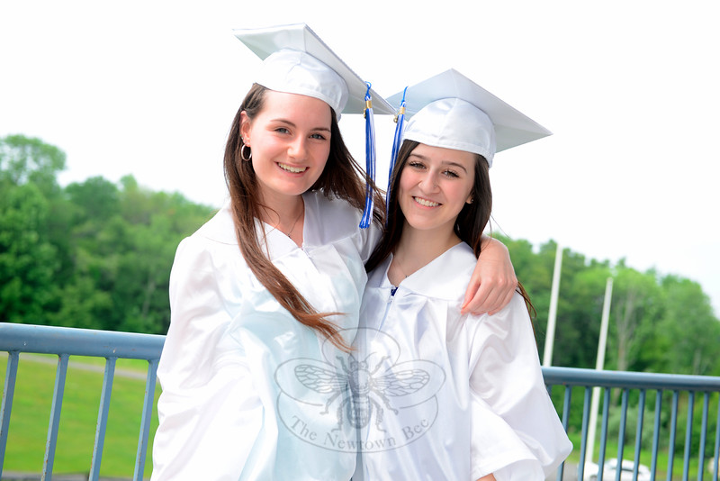 Minutes before the graduation ceremony began Tuesday afternoon, friends Lauren Reseska, left, and Kaylee Perrone shared a hug and a smile. (Bobowick photo)
