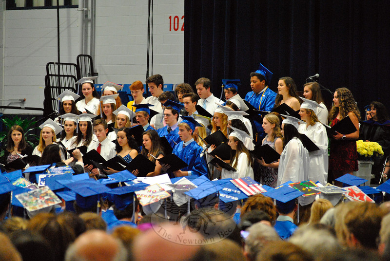"""The Newtown High School Chamber Choir sang """"I'll Be There For You"""" during the graduation ceremony for the Class of 2015 on Tuesday, June 16. (Hallabeck photo)"""