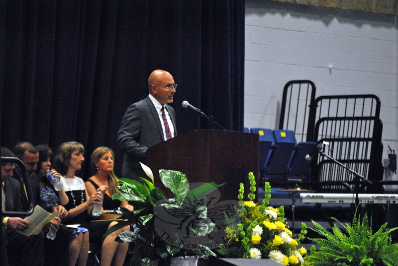 """Newtown Middle School Principal Tom Einhorn welcomed everyone to his school's Moving Up Ceremony, on Monday, June 15, at Western Connecticut State University's O'Neill Center, and in-troduced himself as the school's """"proud principal."""" (Hallabeck photo)"""