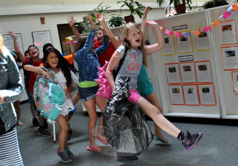Head O' Meadow fourth grade students, led by Ashlynn Bennet, danced in a line just before the final bell of the 2014-15 school year on Wednesday, June 17. (Hallabeck photo)