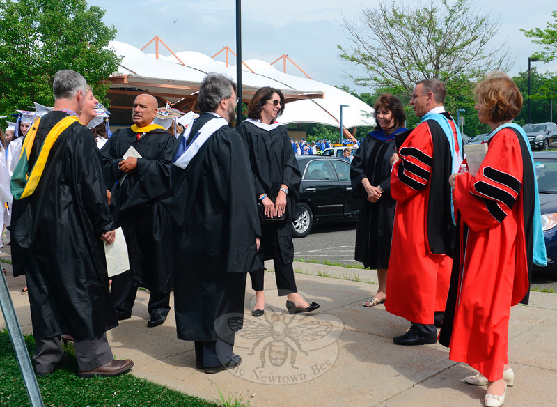 Board of Education members and administrators gathered at what would be the head of the line leading graduates and school staff into the O'Neill Center at Western Connecticut State University for the NHS Class of 2015 graduation ceremony. (Bobowick photo)