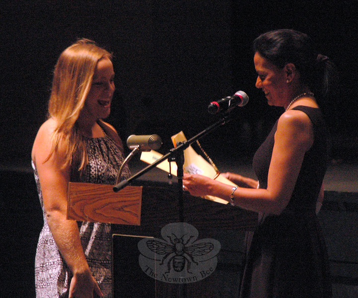 Maggie Conway, right, named and honored Brooke Hadgraft as the NYA Sports & Fitness Scholarship recipient during the Wednesday, June 3, evening event to honor and award scholarships to Newtown High School seniors. (Hallabeck photo)