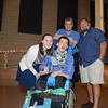 Timmy Rogers is surrounded by, from left, Kira Flynn, his father Ed, and Dave Ciccatsi, dur-ing the 2015 Best Buddies Prom. (Bobowick photo)