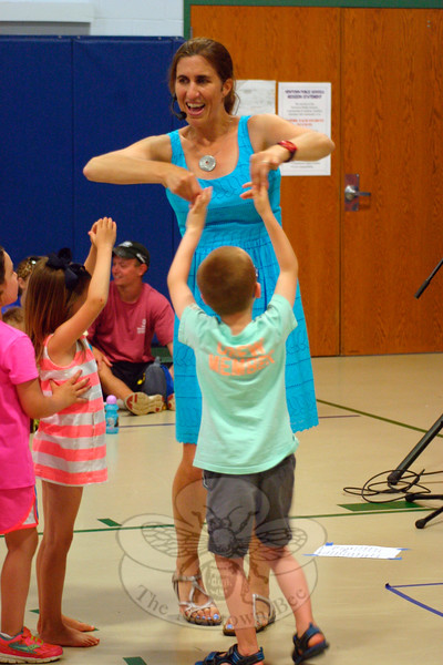 "During the first Summer Jam Concert Series event, Vanessa Trien spins a young audience member during the performance of ""Bubble Song."" The children were following Ms Trien's lead in putting their hands in the air, and mimicking the look of a bubble softly floating through the air. (Hicks photo)"