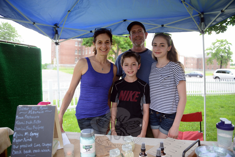 Andrea Brosnan and her husband Kerry worked a table with their son and daughter, Leo and Olivia at the 2015 Farmers Market on the Fairfield Hills opening day, Tuesday, June 23. They represented Newtown-based October Farm Naturals, touting a healthier alternative through chemical-free products. (Bobowick photo)