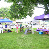 Just a few merchants remained Tuesday afternoon,  the 2015 Farmers Market on the Fairfield Hills opening day, probably getting soaked in a sudden rain that cut short the market's first day. (Bobowick photo)