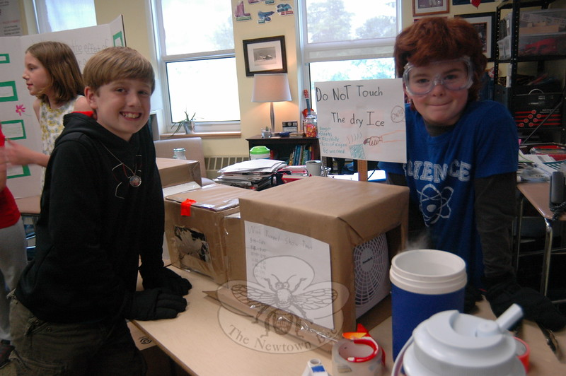 Reed Intermediate School sixth grade students Michael Elston, left, and Luke Sordi, stood with their Science Fair project on Wednesday, June 3. To study aerodynamics the boys created a cardboard wind tunnel with a toy car centered inside to view. (Hallabeck photo)