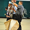 NMS School Resource Officer Lenny Penna, right, opened a surprise gift during an awards ceremony on Tuesday, June 16. The frame and a plaque were given to Officer Penna to commemorate his time at NMS. (Hallabeck photo)