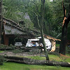 Three trees fell within an Oakview Road property on Wednesday afternoon following a brief but strong storm that knocked down trees and took down power lines across town. At this location, a camper was destroyed and the house was damaged, but there were no reported injuries. (Hicks photo)