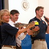 From left, Beardsley Zoo educator Jackie Westlein, Middle Gate Elementary School Principal Chris Geissler, and Beardsley Zoo Educatoion Curator Jim Knox held a boa constrictor named Lester during a presentation for students on Wednesday, June 10. (Hallabeck photo)