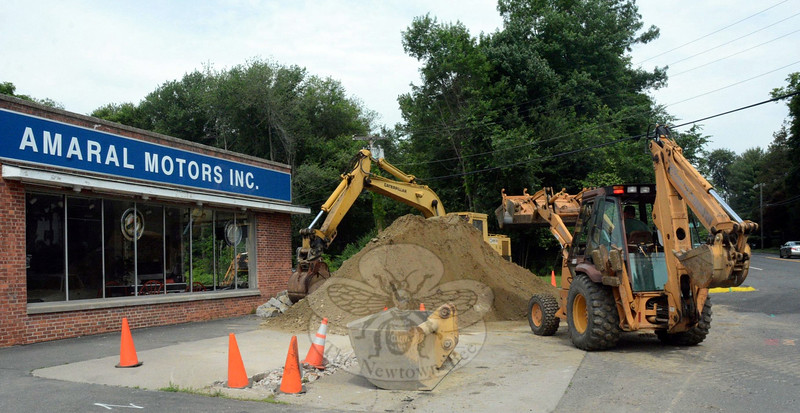 A pile of soil stands in front of Amaral Motors Inc at 40 South Main Street on June 23, where gasoline pumps formerly were located. The business has been having its several underground fuel storage tanks removed. The tank removal is being done to comply with environmental protection regulations. The gasoline pumps were last in use in 2008. (Gorosko photo)