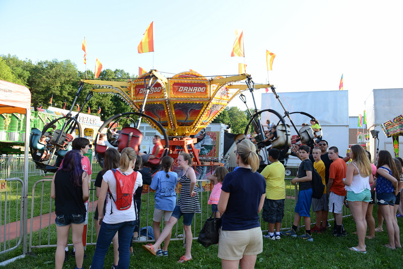 A queue of younger people wait their turn for a ride on the spinning Tornado.  (Bobowick photo)