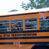 Newtown Middle School students waved goodbye to their teachers from on board a bus on their last day of school.  (Hallabeck photo)