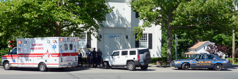 Police report that motorist Stacie Killian, 39, of Dobbs Ferry, N.Y., was driving a 2007 Hummer H-3 SUV at the flagpole intersection of Main Street, Church Hill Road, and West Street at about 10:22 am on June 21, when the Hummer was involved in a one-vehicle collision. A description of what specifically occurred in the accident was not immediately available from police. Hook & Ladder volunteer firefighters and the Newtown Volunteer ambulance Corps responded to the scene. Killian received a verbal warning for making a restricted turn.  (Voket photo)