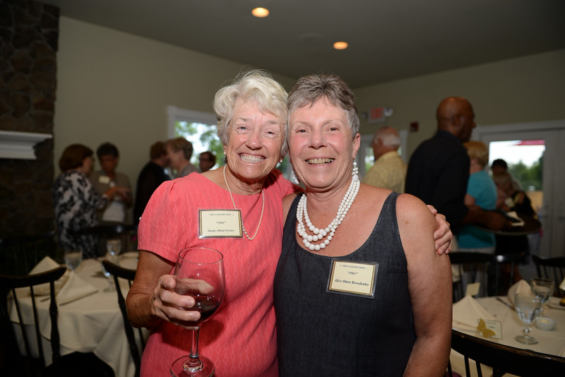 "Class of 1961 graduates Susan ""Missy"" Abbott Forster, left, and Alice Otten Borodenko toasted their many years as friends Saturday.  (Bobowick photo)"