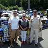 """Stop & Shop Store Manager Rich Marcuccio, far right, FAITH Food Pantry co-chair Nancy Taylor and event co-organizer and Newtown resident Chris Sferruzzo gathered in front of several pallets of food collected during a June 14 car show and raffle held at the South Main Street grocery store in Sand Hill Plaza. The event featured a DJ, the Big Beat Band, food, activities for the kids, and dozens of hot rods, classics, customized, and stock vehicles ranging from vintage to a gull wing DeLorean complete with its space age """"flux capacitor."""" Mr Marcuccio, who has been organizing car shows since 1997 for food pantries in the communities served by his stores, said his event in Newtown raised $10,000 in food and cash donations.  (Voket photo)"""