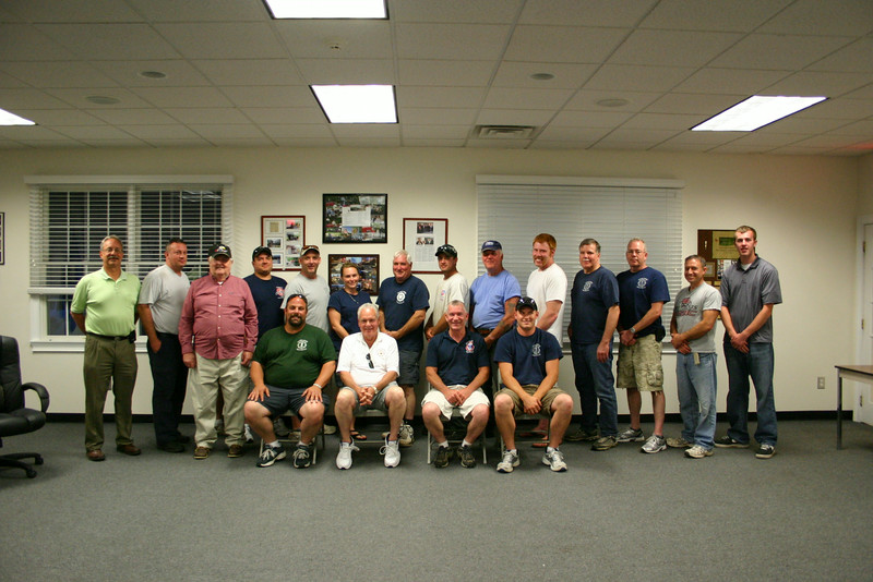 During its annual meeting earlier this month, the membership of Sandy Hook Volunteer Fire & Rescue elected its officers for 2014-15. Chief Bill Halstead will remain as chief for an-other year, which means he will begin his 37th year in that position next month. Following are the officers and their elected positions: from left, seated, Assistant Chief Anthony Capozziello; Chief Halstead; 1st Assistant Chief Mike Burton; and 2nd Assistant Chief Ryan Clark; standing, are President Bradley Richardson; Captain John Jeltema; Lieutenant Kevin Stoyak (hiding); Vice President George Lockwood, Sr; 1st Engineer Matt Dobson; 2nd Engineer Tim Whelan; EMT Captain, Secretary and Treasurer Karin Halstead; and Engineers George Lockwood, Jr, Stephen Clark, Steven Stohl, Brian Engelke, W. Randy Muller, Scott Allen, Matt Roberto, and John Fellin. The positions take effect July 1.  (Hicks photo)
