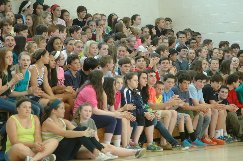 Eighth graders gathered on bleachers in Newtown Middle School's main gymnasium for the school's annual awards assembly. (Hallabeck photo)