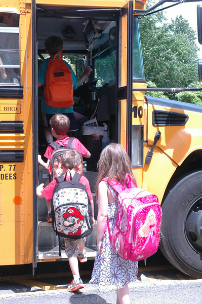 Hawley Elementary School students got on the school bus after school dismissed for the last time for the 2013-14 school year.  (Hallabeck photo)