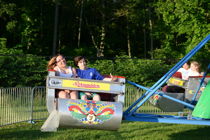 Sharing a ride on the Scramblr on Tuesday, June 24, opening night of the St Rose Parish Carnival.  (Bobowick photo)
