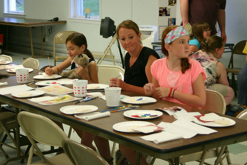 More than 500 Hearts of Hope have been created in Newtown since May 2013. The HOH-Newtown chapter, officially recognized last July, celebrated its first anniversary with a painting party on June 18. Among those attending were Barb Tarpey, center, and her daughters Paige, left, and Meghan.  (Hicks photo)